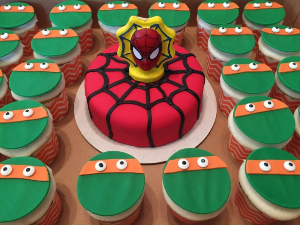 Spider-Man mini cake and TMNT Michelangelo cupcakes