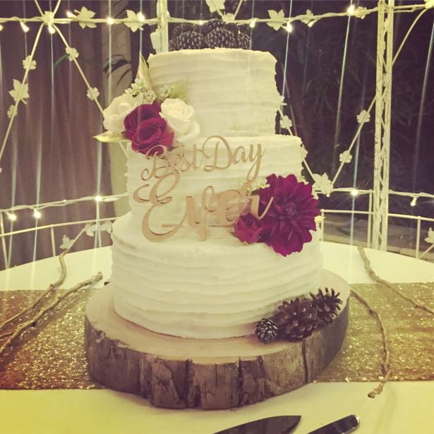 """Best Day Ever"" Buttercream Striped Wedding Cake with Flowers and Pinecones"