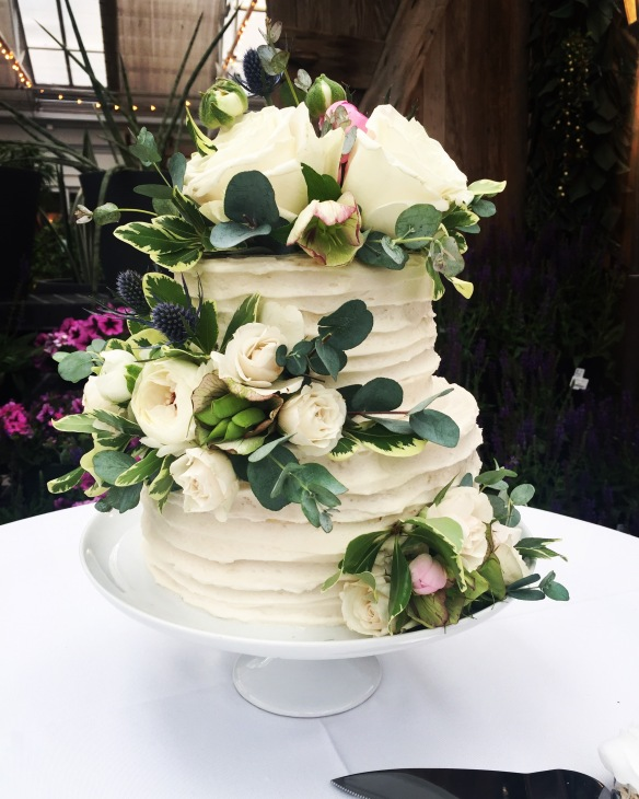Buttercream striped wedding cake with white flowers and greenery buttercream striped wedding cake with white flowers and greenery mightylinksfo
