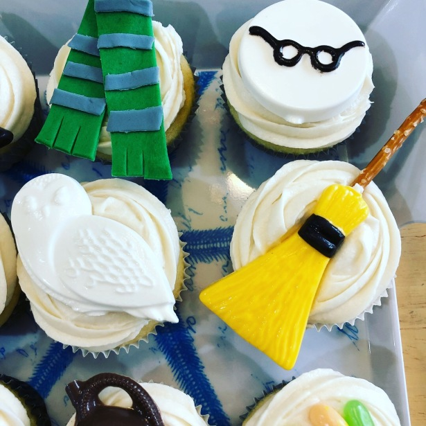 a Slytherin scarf, Harry Potter glasses, Hedwig and a broomstick