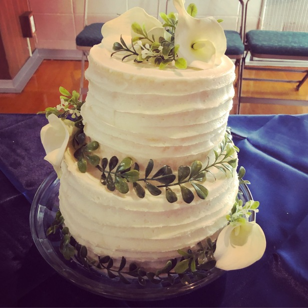 Buttercream Striped Wedding Cake with Lilies and Greens
